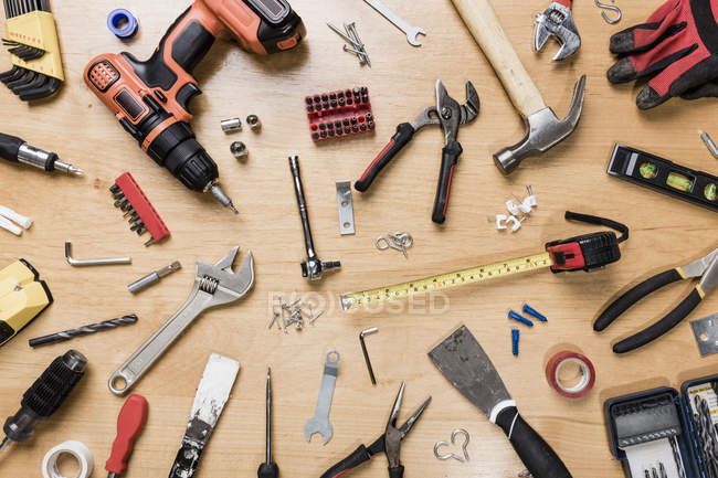 View from above tools on wooden table - knolling — Stock Photo