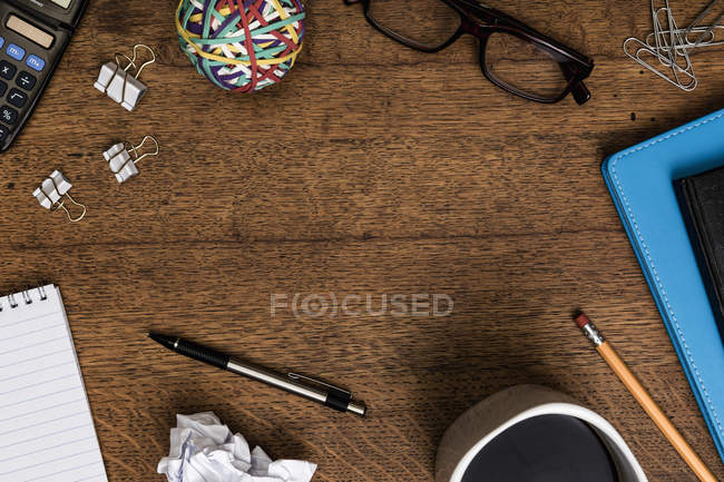 View from above office supplies on wooden desk — Stock Photo