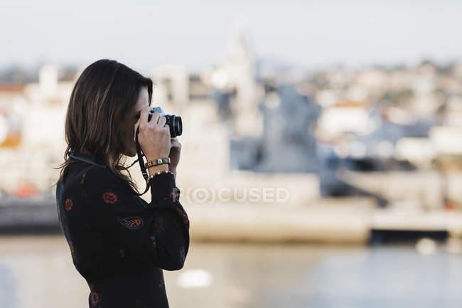 Female tourist using camera, Cascais, Lisbon, Portugal — Stock Photo