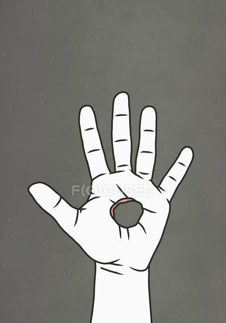 Hole in hand on grey background — Stock Photo