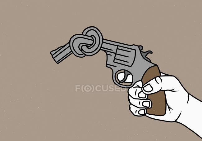 Homme retenant le pistolet noué — Photo de stock