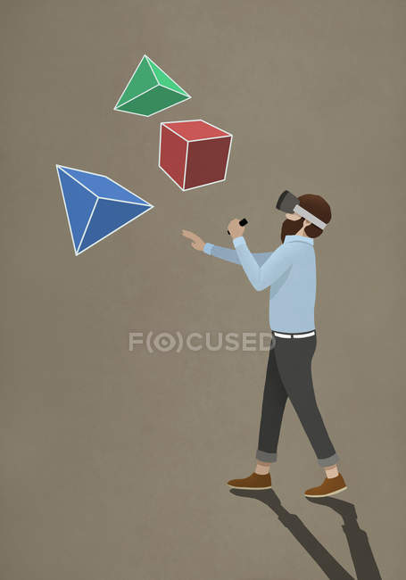 Man with virtual reality simulator glasses looking at 3D geometric shapes — Stock Photo