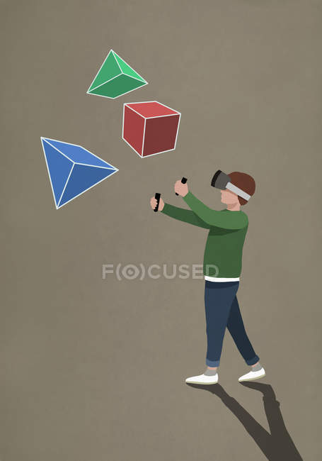 Boy with virtual reality simulator glasses looking at 3D geometric shapes — Stock Photo