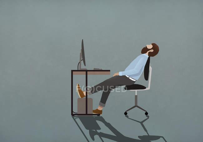 Tired businessman sleeping at desk — Stock Photo
