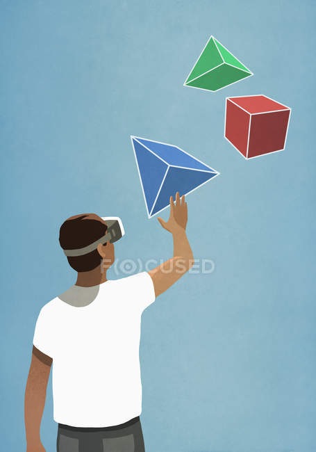 Man with virtual reality simulator glasses looking up at 3D geometric shapes — Stock Photo