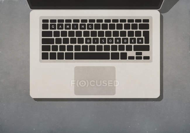 Desordem de jogos texto no teclado do laptop — Fotografia de Stock