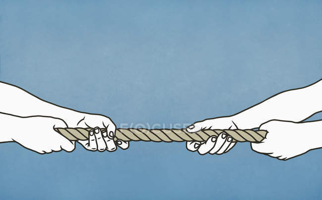 Men playing tug-of-war with rope — Stock Photo