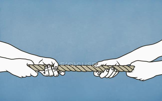 Homens jogando cabo-de-guerra com corda — Fotografia de Stock