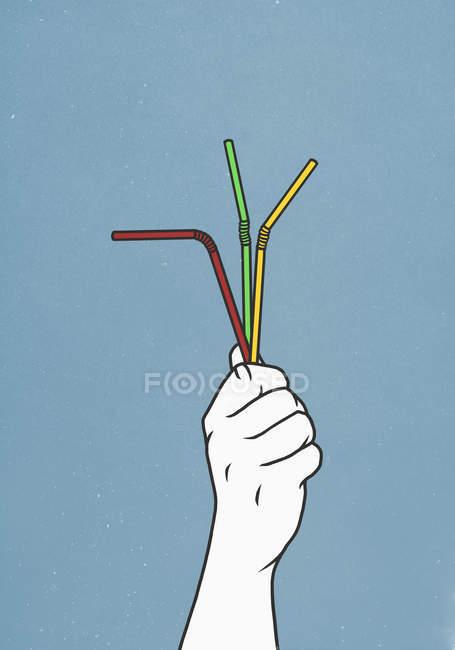 Man holding three straws — Stock Photo