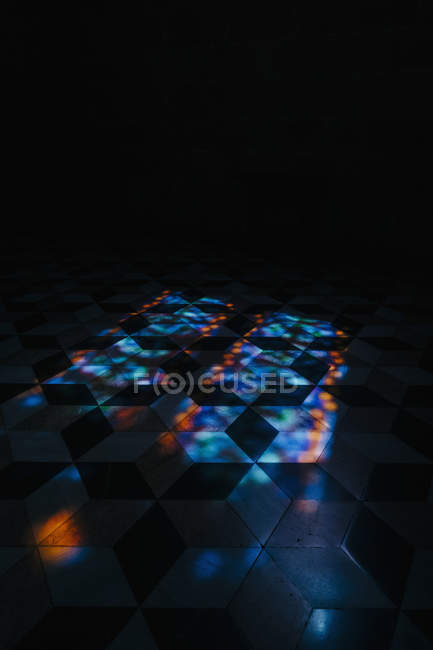 Kaleidoscope reflection of lights on tile floor — Stock Photo