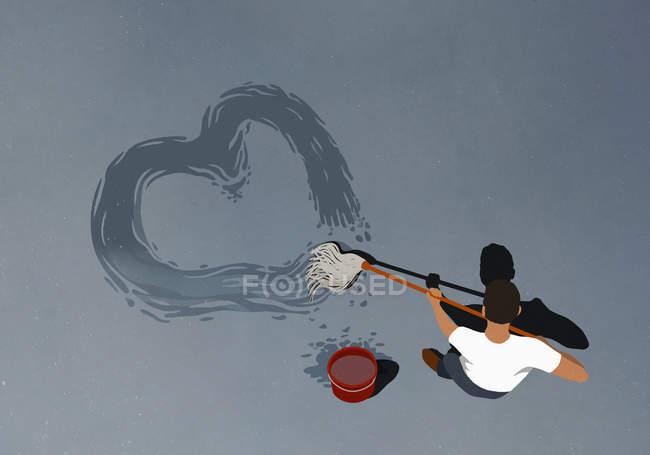 Человек, рисующий сердце шваброй. — стоковое фото