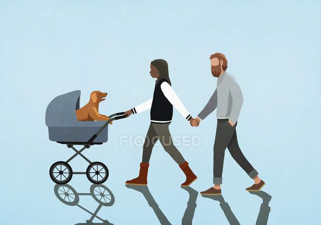 Пара тримається за руки і йде цуценя в колясці. — стокове фото