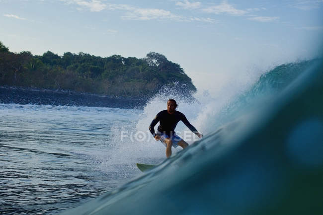 Male surfer riding ocean wave — Stock Photo