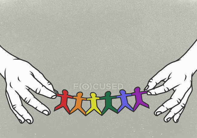 Hands holding LGBTQI rainbow paper chain — Stock Photo