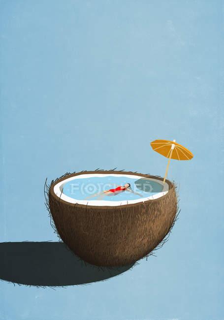Frau schwimmt in tropischem Kokosnusspool — Stockfoto