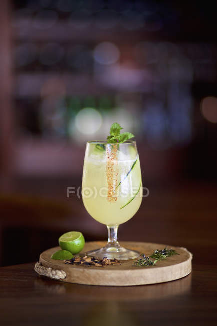 Gourmet lime margarita on wooden serving board — Stock Photo