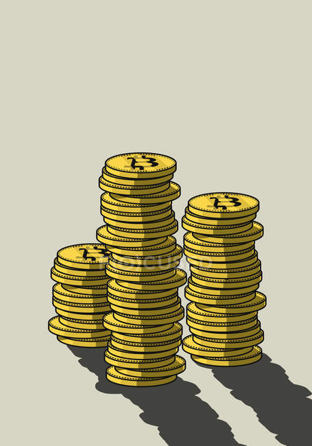 Stacks of Bitcoins on beige background — Stock Photo