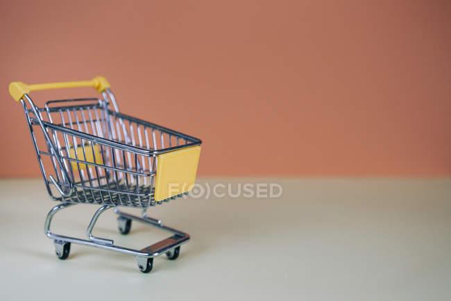 Tiny toy shopping cart — Stock Photo