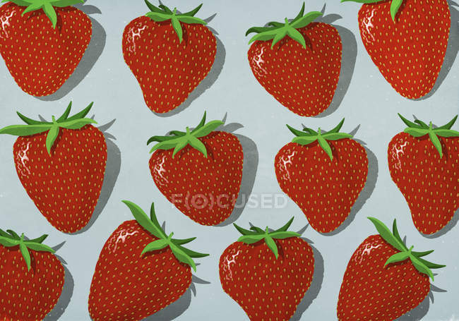 Vibrant red strawberries on gray background — Stock Photo