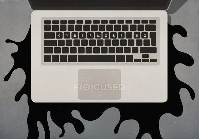 Cybermobbing text on laptop keyboard — Stock Photo