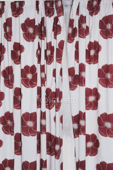 Red flowers on white curtains — Stock Photo