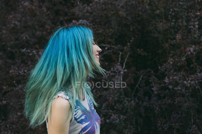 Profile of carefree young woman with blue hair — Stock Photo