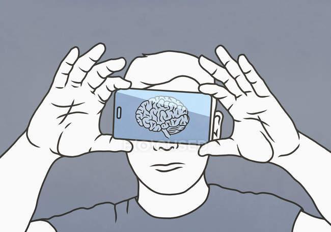 Мозок на екрані смартфона над людиною обличчям — стокове фото