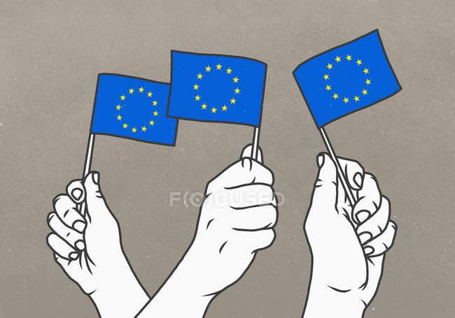 Hommes arborant de petits drapeaux de l'Union européenne — Photo de stock