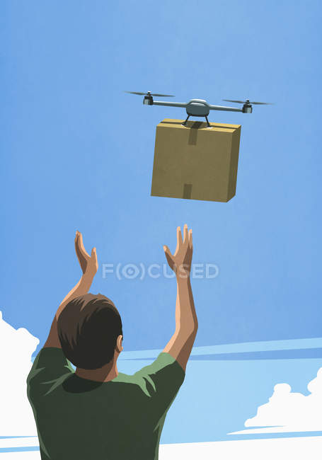 Man releasing drone with cardboard box delivery — Stock Photo
