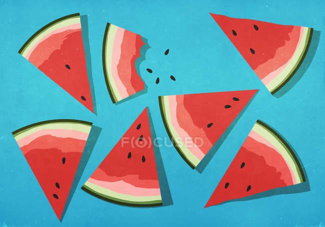 Fatias vibrantes de melancia no fundo azul — Fotografia de Stock