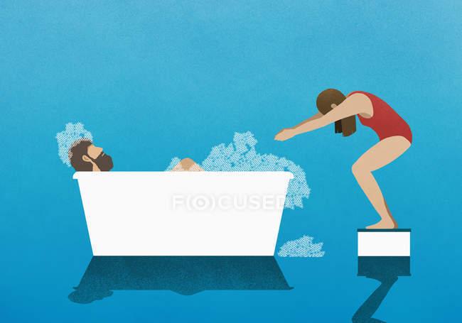 Esposa en bloque de buceo preparándose para sumergirse en baño de burbujas con el marido - foto de stock