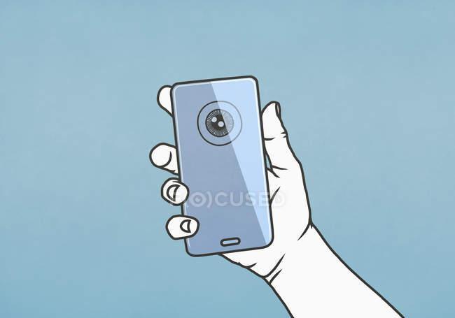 Чоловік тримає смартфон з сітківкою. — стокове фото