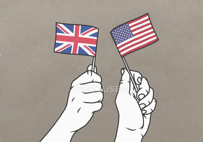 Men waving small British and American flags — Stock Photo