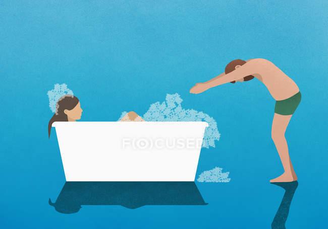 Esposo preparándose para sumergirse en baño de burbujas con su esposa - foto de stock
