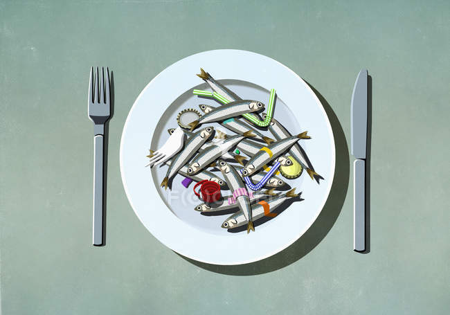 Sardines, plastic straws and pollution on plate — Stock Photo