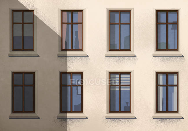 Shadow over apartment building with windows — Stock Photo