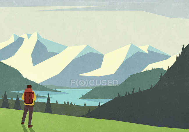 Male backpacker looking at tranquil mountain landscape view — Stock Photo