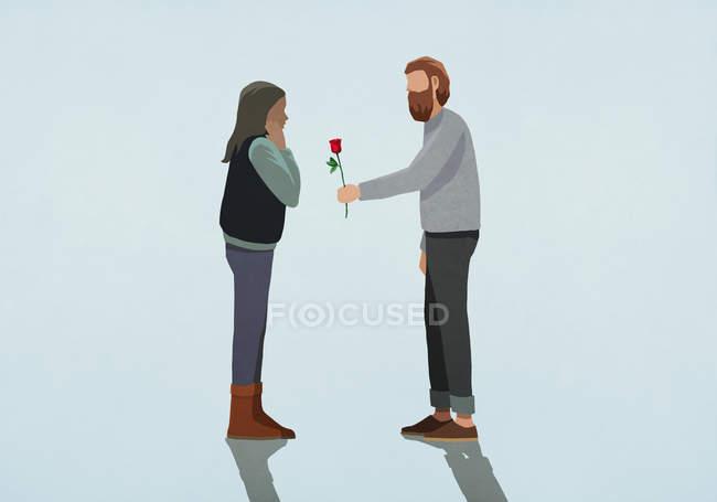 El hombre dando rosa a la novia sorprendida - foto de stock