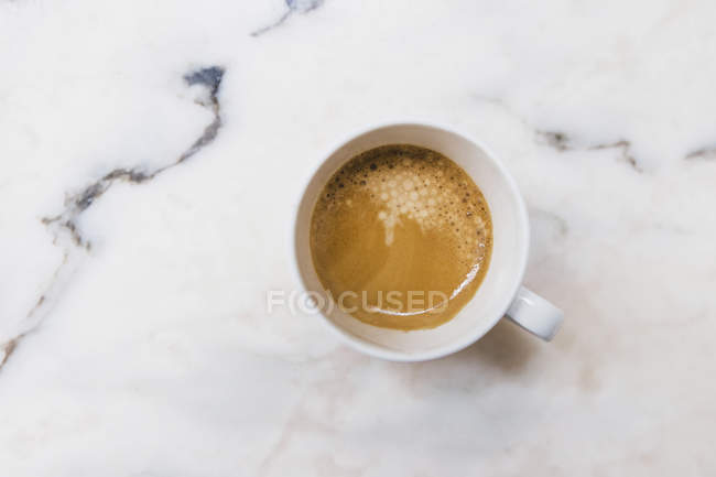 View from above of espresso in mug on marble surface — Stock Photo
