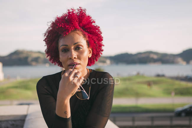 Portrait of confident, serious woman with red hair — Stock Photo