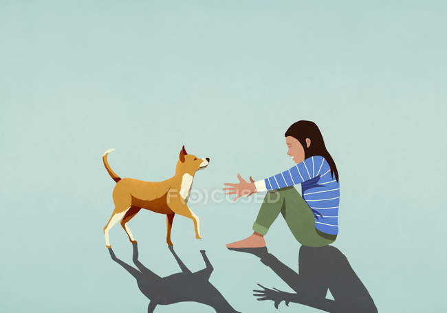Dog walking toward woman with arms outstretched — Stock Photo