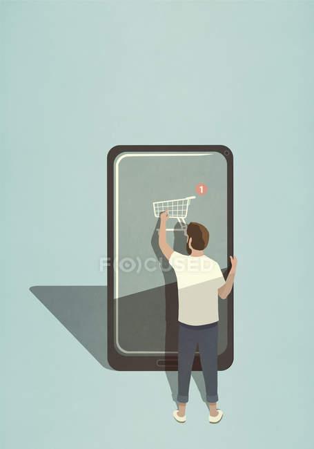 Mann kauft online mit Handy-App auf großem Smartphone ein — Stockfoto