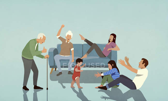 Happy multi-generation family cheering in living room — Stock Photo