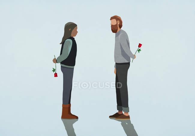 Couple holding roses behind backs — Stock Photo