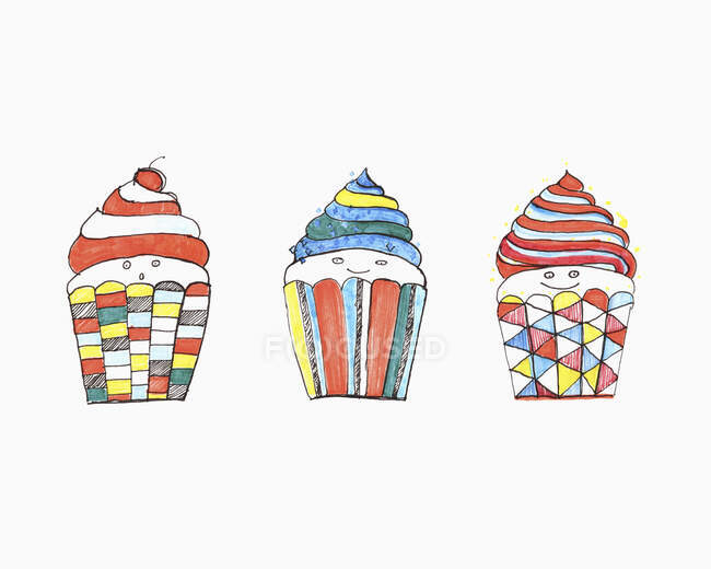Vibrant colored anthropomorphic cupcakes — Stock Photo