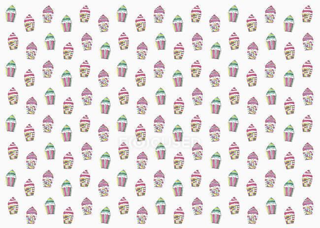Pastell gefärbte Cupcakes auf weißem Hintergrund — Stockfoto