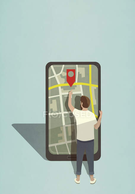 Man reaching for map pin icon on large smart phone — Stock Photo