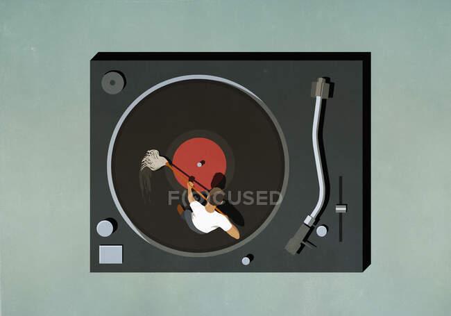 Man scrubbing vinyl record — Stock Photo
