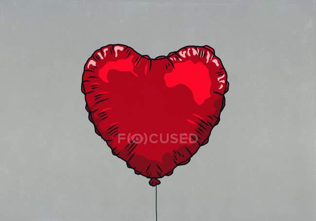Roter herzförmiger Heliumballon — Stockfoto