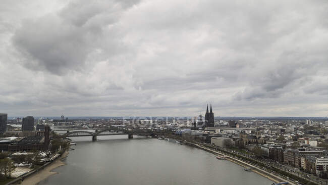 Clouds over Cologne cityscape and Rhine River, Germany — стокове фото